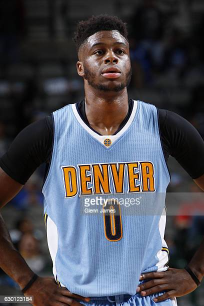 Emmanuel Mudiay of the Denver Nuggets looks on during the game against the Dallas Mavericks on December 12 2016 at the American Airlines Center in...