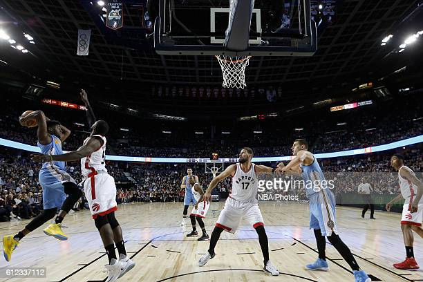 Emmanuel Mudiay of the Denver Nuggets passes the ball against the Toronto Raptors on October 3 2016 at the Scotiabank Saddledome in Calagary Alberta...