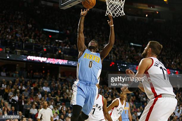 Emmanuel Mudiay of the Denver Nuggets shoots the ball against the Toronto Raptors on October 3 2016 at the Scotiabank Saddledome in Calagary Alberta...