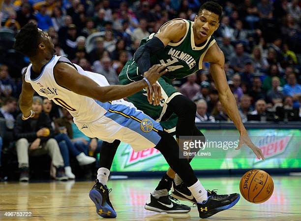 Emmanuel Mudiay of the Denver Nuggets takes a charge for Giannis Antetokounmpo of the Milwaukee Bucks during the third quarter at the Pepsi Center on...
