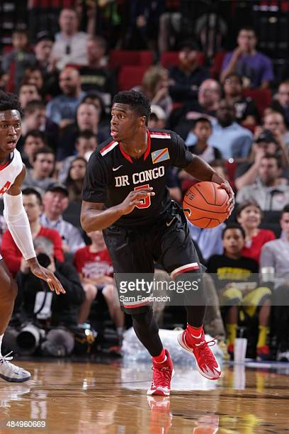 Emmanuel Mudiay of the World Team dribbles the ball during the game against Team USA on April 12 2014 at the Moda Center Arena in Portland Oregon...