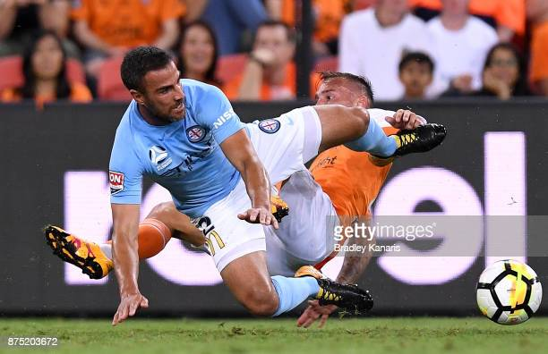 Emmanuel Muscat of Melbourne City and Eric Bautheac of the Roar challenge for the ball during the round seven ALeague match between Brisbane Roar and...