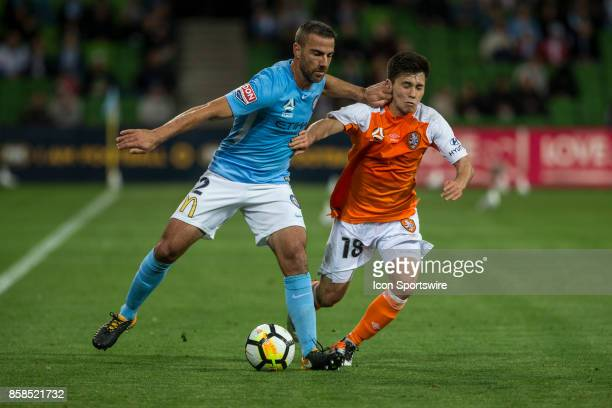 Emmanuel Muscat of Melbourne City and Joe Caletti of the Brisbane Roar contest the ball during Round 1 of the Hyundai ALeague Series between Brisbane...