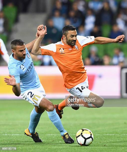 Emmanuel Muscat of the City and Fahd Ben Khalfallah of the Roar compete for the ball during the round one ALeague match between Melbourne City FC and...