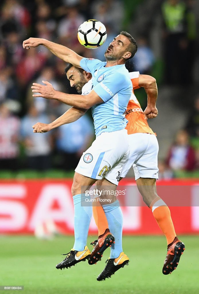 Emmanuel Muscat of the City and Fahd Ben Khalfallah of the Roar compete to head the ball during the round one A-League match between Melbourne City FC and the Brisbane Roar at AAMI Park on October 6, 2017 in Melbourne, Australia.