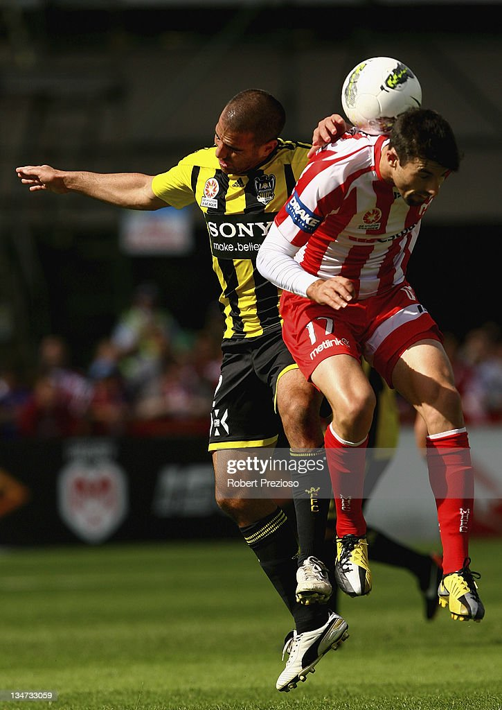 Emmanuel Muscat of the Phoenix and Jason Hoffman of the Heart contest the ball during the round nine A-League match between the Melbourne Heart and the Wellington Phoenix at Latrobe City Sports & Entertainment Complex on December 4, 2011 in Melbourne, Australia.