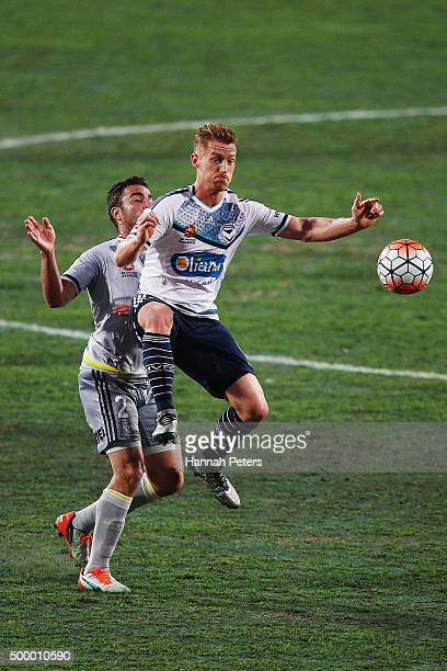 Emmanuel Muscat of the Wellington Phoenix competes for the ball with Oliver Bozanic of the Melbourne Victory during the round nine ALeague match...