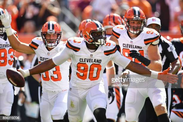 Emmanuel Ogbah of the Cleveland Browns reacts to recovering a fumble in the first half against the Cincinnati Bengals at FirstEnergy Stadium on...