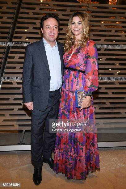 Emmanuel Perrotin and wife Lorena Vergani attend 'Etre Moderne Le MoMA A Paris' Exhibition at Fondation Louis Vuitton on October 9 2017 in Paris...