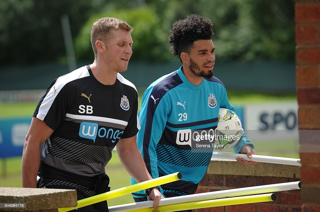Emmanuel Riviere (R) carry's training kit inside with staff Sean Beech (L) during fitness testing on the first day back at The Newcastle United training Centre on July 1, 2016 in Newcastle upon Tyne, England.