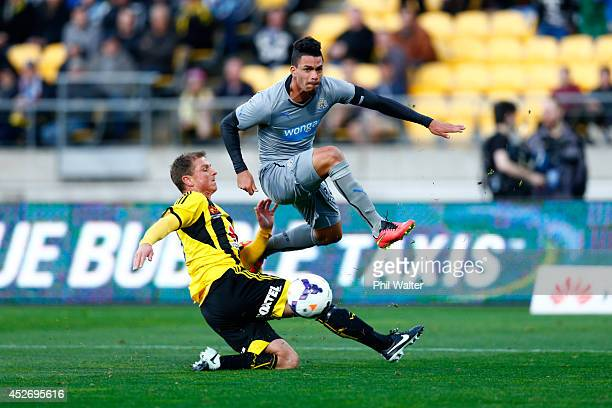 Emmanuel Riviere of Newcastle shoots over Ben Sigmund of the Phoenix during the Football United New Zealand Tour match between the Wellington Phoenix...