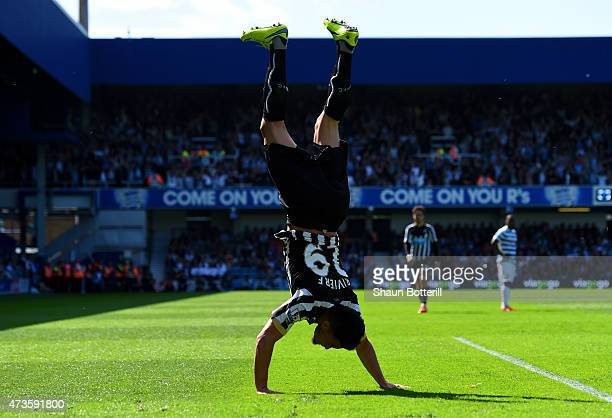 Emmanuel Riviere of Newcastle United celebrates scoring the opening goal during the Barclays Premier League match between Queens Park Rangers and...