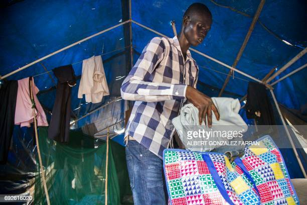 Emmanuel Samuel 17 years old packs his clothes in his caretakers' house in Juba South Sudan before being reunited with his family on June 4 2017...