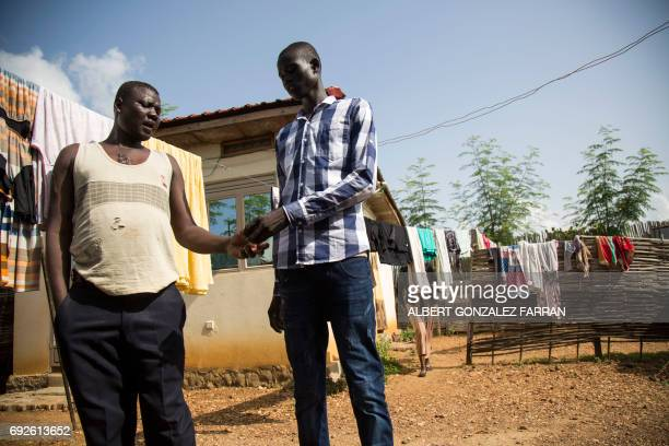 Emmanuel Samuel 17 years old says goodbye to his caretaker Simon Civil in Juba South Sudan before being reunited with his family on June 4 2017...