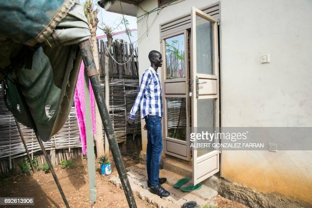 Emmanuel Samuel 17 years old says goodbye to his caretakers in Juba South Sudan before being reunited with his family on June 4 2017 Emmanuel from...