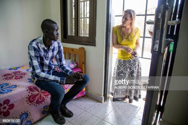 Emmanuel Samuel 17 years old talks with ICRC protection coordinator Celine Croon in a transit accommodation in ICRC compound in Juba South Sudan on...