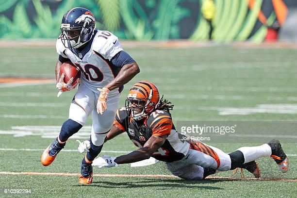 Emmanuel Sanders of the Denver Broncos breaks a tackle by Adam Jones of the Cincinnati Bengals during the first quarter at Paul Brown Stadium on...