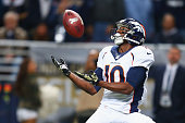 Emmanuel Sanders of the Denver Broncos catches a 42yard touchdown pass against the St Louis Rams in the second quarter t the Edward Jones Dome on...