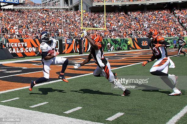 Emmanuel Sanders of the Denver Broncos catches a pass over the defense of Adam Jones of the Cincinnati Bengals for a touchdown during the second...