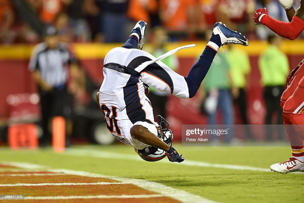 Emmanuel Sanders of the Denver Broncos flips into the endzone for a touchdown during a game against the Kansas City Chiefs at Arrowhead Stadium on...