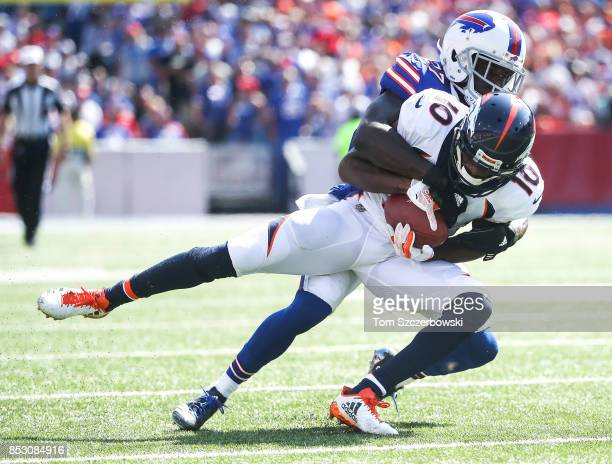 Emmanuel Sanders of the Denver Broncos is tackled by Tre'Davious White of the Buffalo Bills during an NFL game on September 24 2017 at New Era Field...