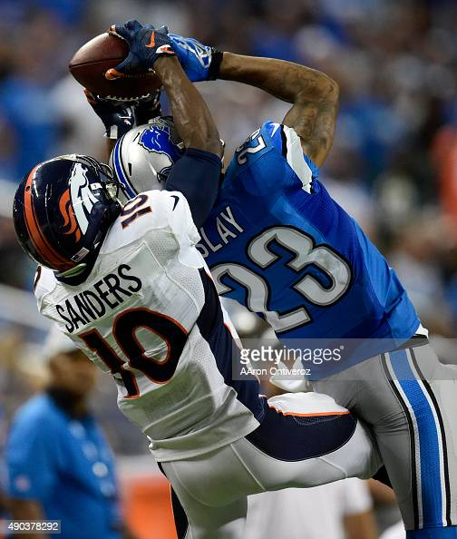 Emmanuel Sanders of the Denver Broncos makes a key first down reception over Darius Slay of the Detroit Lions that would set up a touchdown by Owen...