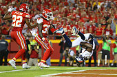 Emmanuel Sanders of the Denver Broncos summersaults into the endzone ahead of Marcus Peters and Ron Parker of the Kansas City Chiefs after a...