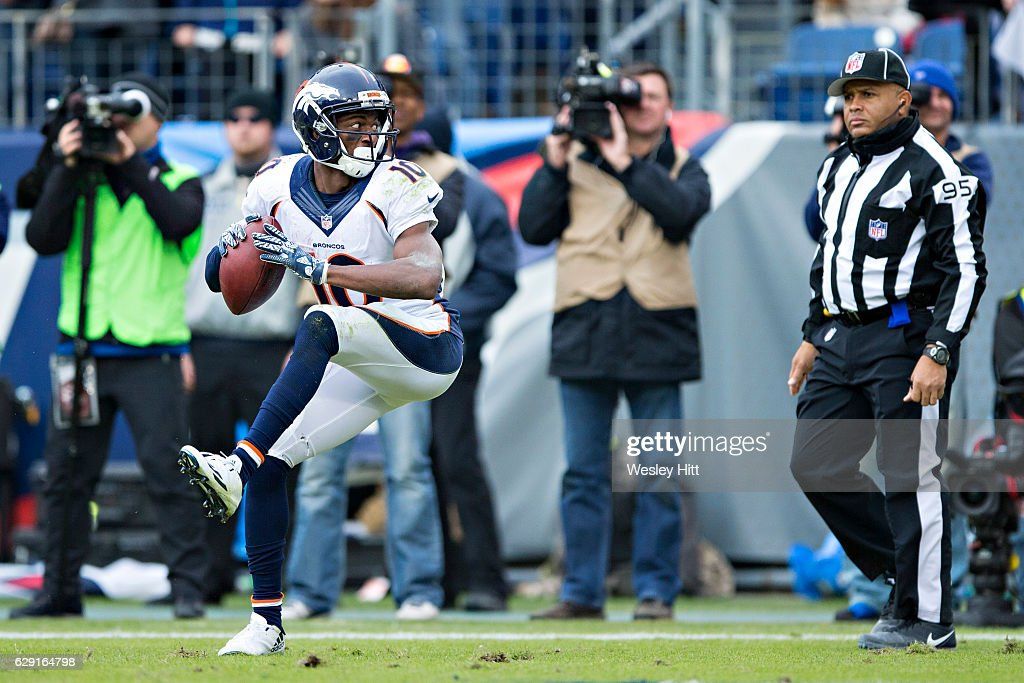 Emmanuel Sanders #10 of the Denver Broncos throws the ball against the backdrop after scoring a touchdown and is called for unsportsmanlike conduct during a game against the Tennessee Titans at Nissan Stadium on December 11, 2016 in Nashville, Tennessee. The Titans defeated the Broncos 13-10.