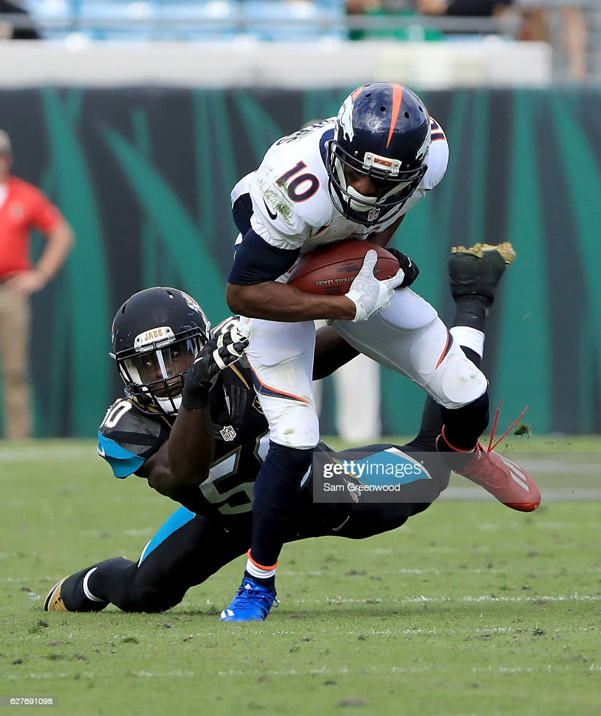 Emmanuel Sanders #10 of the Denver Broncos tries to break the tackle of Telvin Smith #50 of the Jacksonville Jaguars at EverBank Field on December 4, 2016 in Jacksonville, Florida.
