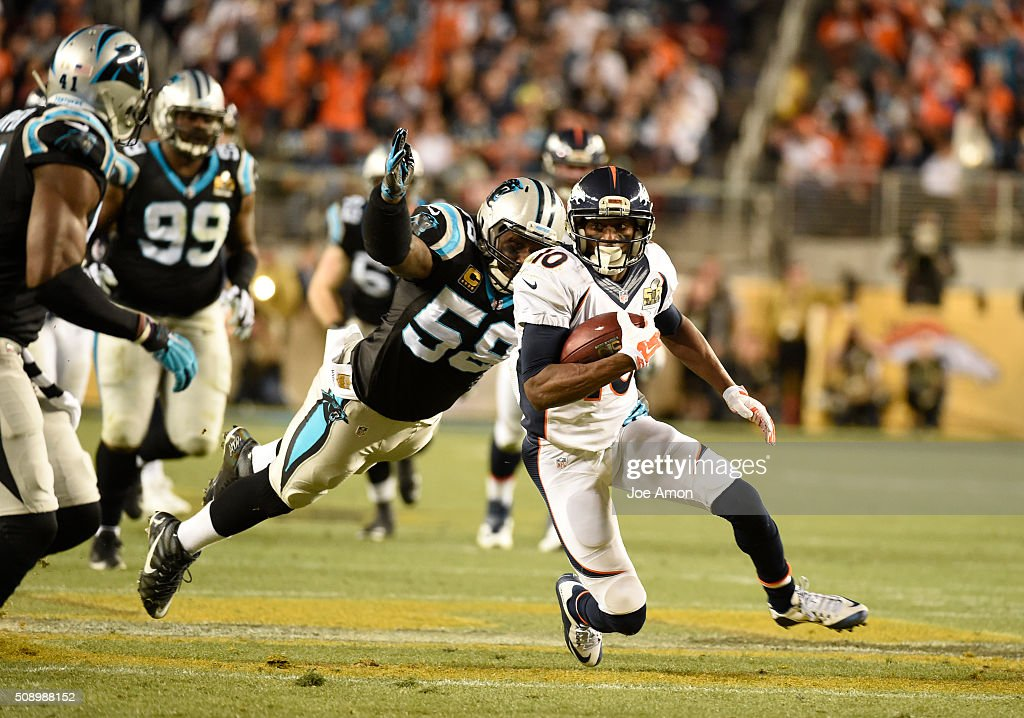 Emmanuel Sanders of the Denver Broncos tries to outrun Thomas Davis of the Carolina Panthers who leaps out to tackle him in the third quarter The...