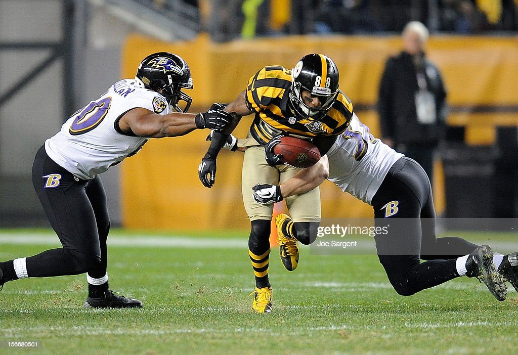 Emmanuel Sanders #88 of the Pittsburgh Steelers breaks through the defense of Albert McClellan #50 and Sean Considine #37 of the Baltimore Ravens on November 18, 2012 at Heinz Field in Pittsburgh, Pennsylvania.