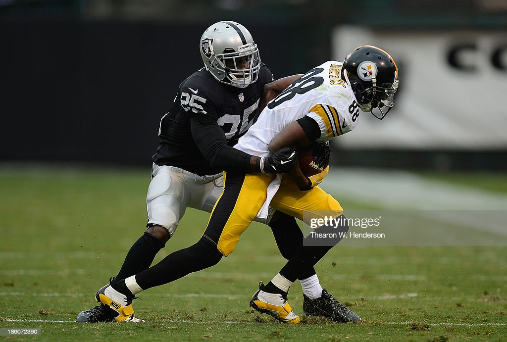 Emmanuel Sanders of the Pittsburgh Steelers gets wrapped up by DJ Hayden of the Oakland Raiders during the fourth quarter at Oco Coliseum on October...