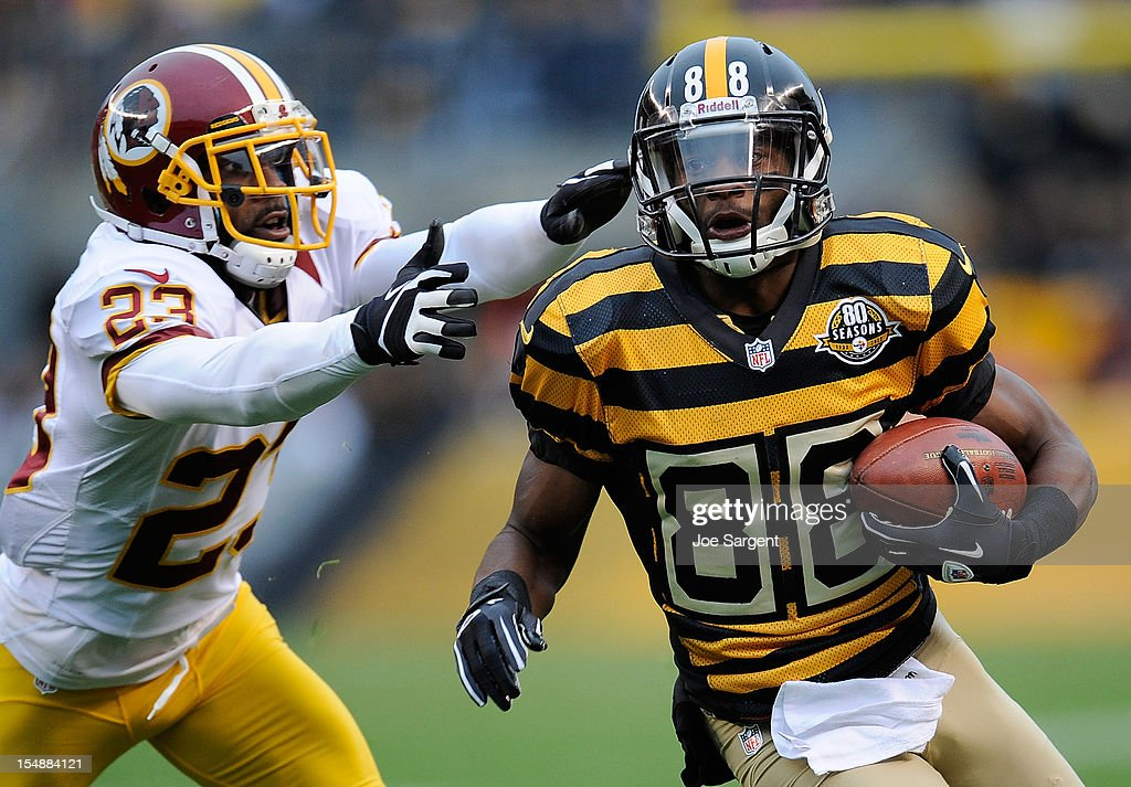 Emmanuel Sanders #88 of the Pittsburgh Steelers runs past the defense of <a gi-track='captionPersonalityLinkClicked' href=/galleries/search?phrase=DeAngelo+Hall&family=editorial&specificpeople=209065 ng-click='$event.stopPropagation()'>DeAngelo Hall</a> #23 of the Washington Redskins on October 28, 2012 at Heinz Field in Pittsburgh, Pennsylvania. Pittsburgh won the game 27-12.