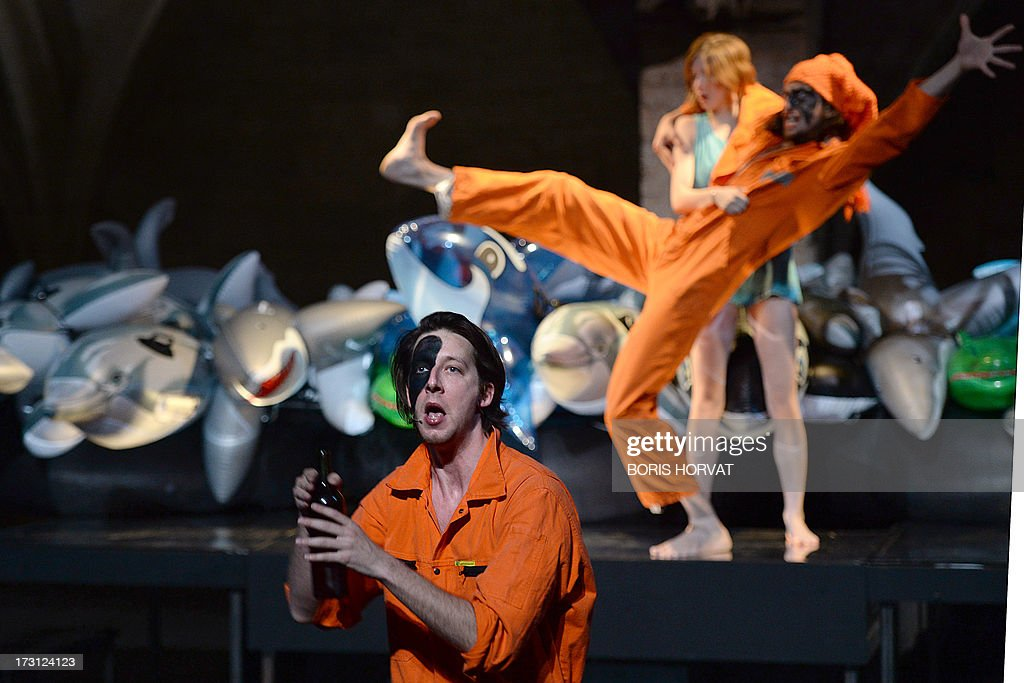 Emmanuel Schwartz, Romy Louise Lauwers and Maarten Seghers perform a play written and directed Belgian Jan Lauwers 'Place du marché 76' on July 7, 2013 in Avignon, during the 67th International Theatre festival.