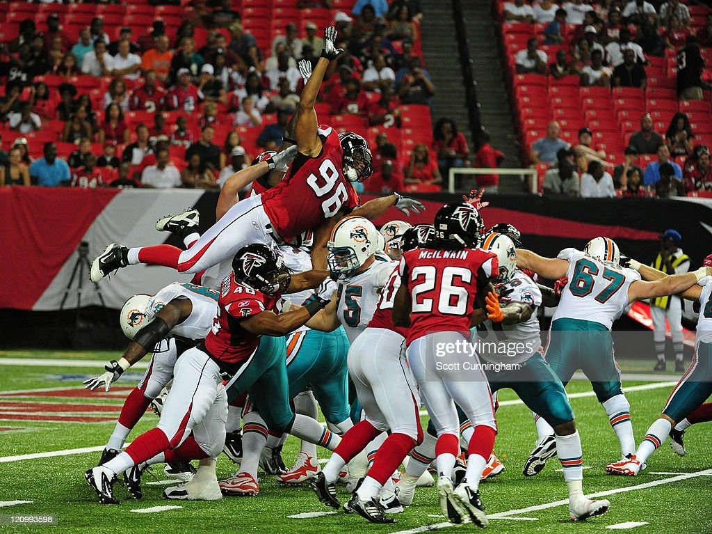 Emmanuel Stephens #96 of the Atlanta Falcons goes up to block an extra point against the Miami Dolphins during a preseason game at the Georgia Dome on August 12, 2011 in Atlanta, Georgia.