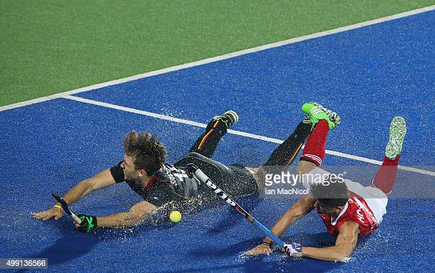 Emmanuel Stockbroekx of Belgian vies with Gabriel HoGarcia of Canada during the match between Belgium and Canada on day three of The Hero Hockey...