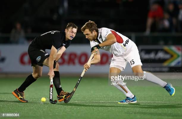 Emmanuel Stockbroekx of Belgium and Hayden Phillips of New Zealand battle for possession during the Quarter final match between Belgium and New...
