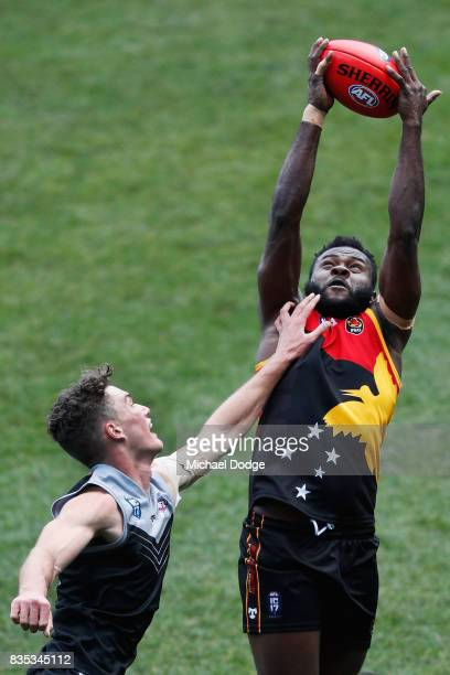 Emmanuel TUPIA of Papua New Guinea marks the ball against Barclay MILLER of New Zealand during the 2017 AFL International Cup Grand FInal match...