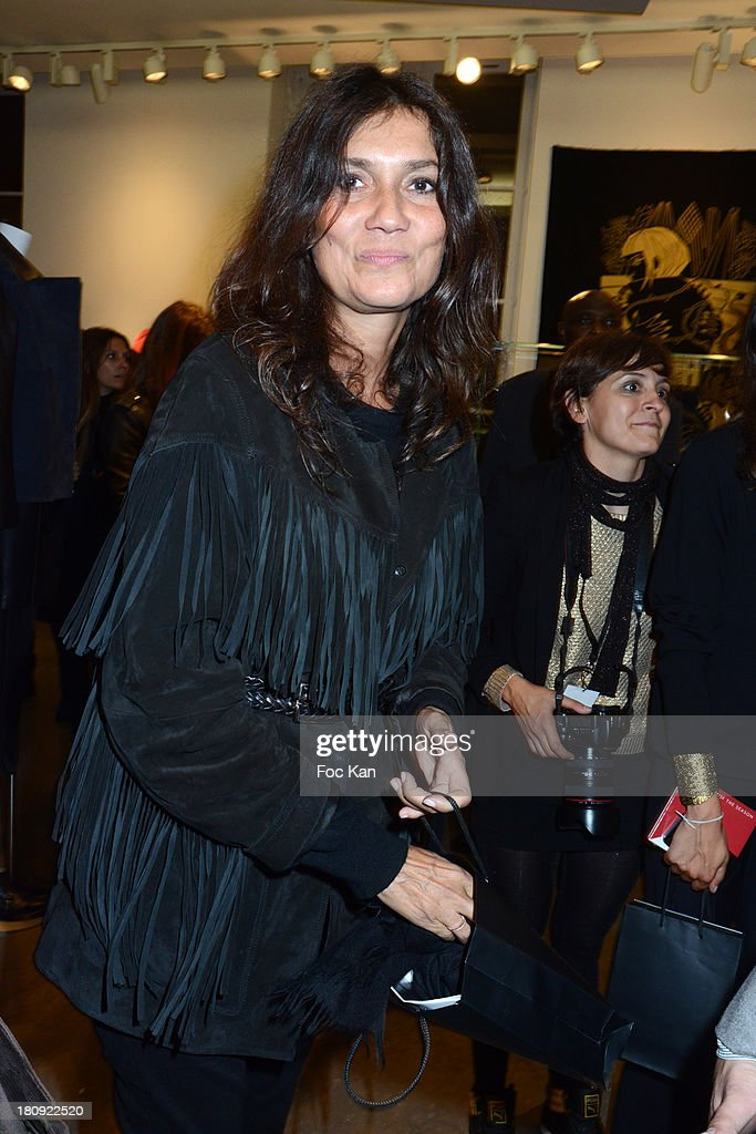 Emmanuelle Alt attends the Colette Shop Cocktail during the Vogue Fashion Night Out on Rue Saint Honore on September 17, 2013 in Paris, France.