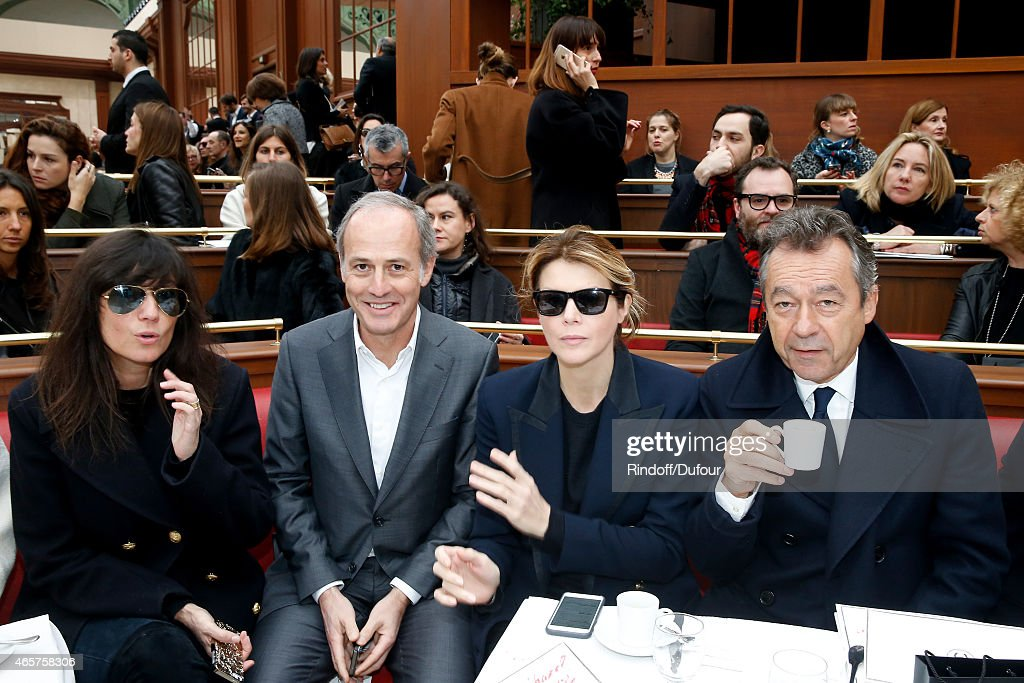 Emmanuelle Alt, CEO of group Conde Nast France Xavier Romatet, Journalist Virginie Mouzat and Michel Denisot attend the Chanel show as part of the Paris Fashion Week Womenswear Fall/Winter 2015/2016 on March 10, 2015 in Paris, France.