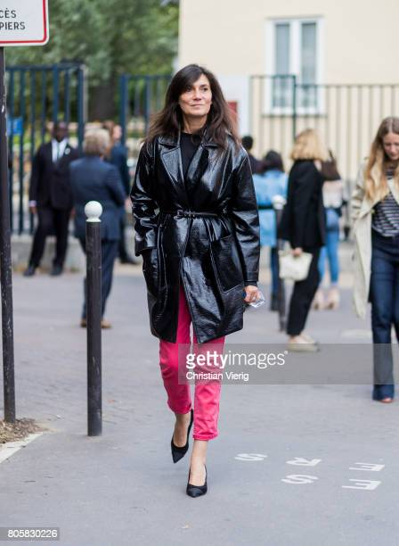 Emmanuelle Alt wearing black leather coat red cropped pants outside Rodarte during Paris Fashion Week Haute Couture Fall/Winter 20172018 Day One on...