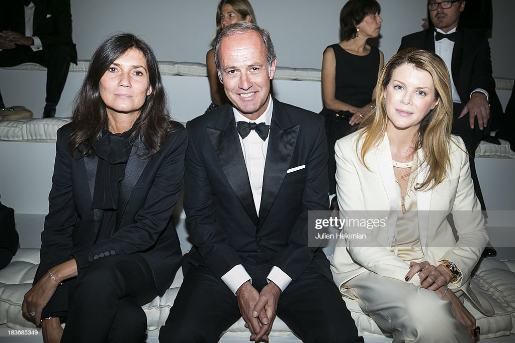 <a gi-track='captionPersonalityLinkClicked' href=/galleries/search?phrase=Emmanuelle+Alt&family=editorial&specificpeople=758682 ng-click='$event.stopPropagation()'>Emmanuelle Alt</a>, Xavier Romatet and Virginie Mouzat attend the presentation of the Ralph Lauren Fall 13 Collection Show at Les Beaux-Arts de Paris on October 8, 2013 in Paris, France. On this occasion Ralph Lauren celebrates the restoration project and patron sponsorship of L'Ecole des Beaux-Arts.