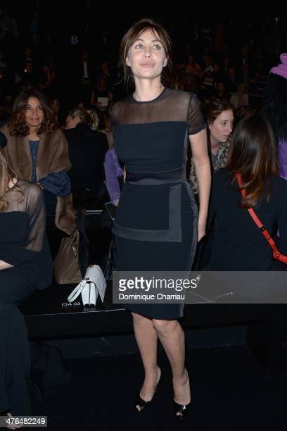 Emmanuelle Beart attends the Elie Saab show as part of the Paris Fashion Week Womenswear Fall/Winter 20142015 on March 3 2014 in Paris France