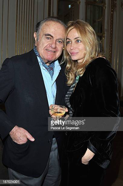 Emmanuelle Beart poses with her father Guy Beart after being honored the Officier des Arts et des Lettres at Ministere de la Culture on November 27...