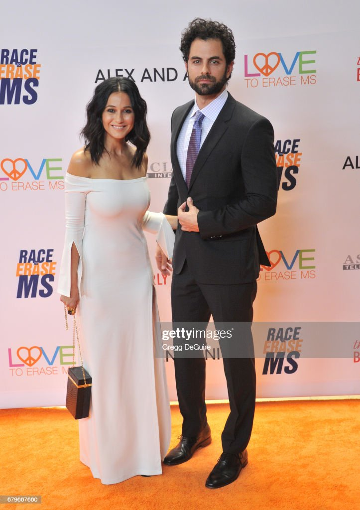 Emmanuelle Chriqui and Adrian Bellani arrive at the 24th Annual Race To Erase MS Gala at The Beverly Hilton Hotel on May 5, 2017 in Beverly Hills, California.