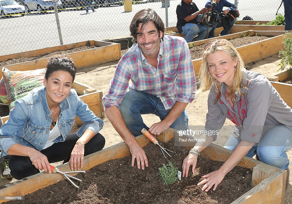 Emmanuelle Chriqui, Carter Oosterhouse and Amy Smart attend the Environmental Media Association's celebration of Earth Day at Cochran Middle School on April 18, 2013 in Los Angeles, California.