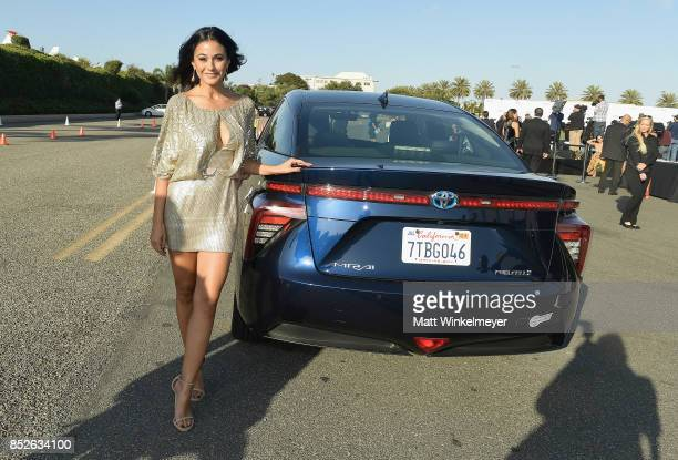 Emmanuelle Chriqui poses with the Toyora Mirai the zero emissions car during the 2017 EMA Awards Presented by Toyota on September 23 2017 in Santa...
