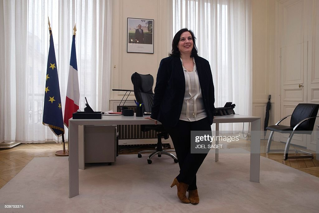 Emmanuelle Cosse, named as French housing minister, poses in her office on February 12, 2016, after the handover ceremony in Paris. French President Francois Hollande reshuffled his cabinet on February 11, 2016, naming Jean-Marc Ayrault foreign minister and adding several ecologists to government as he seeks to widen his political base ahead of a presidential poll in 2017. SAGET
