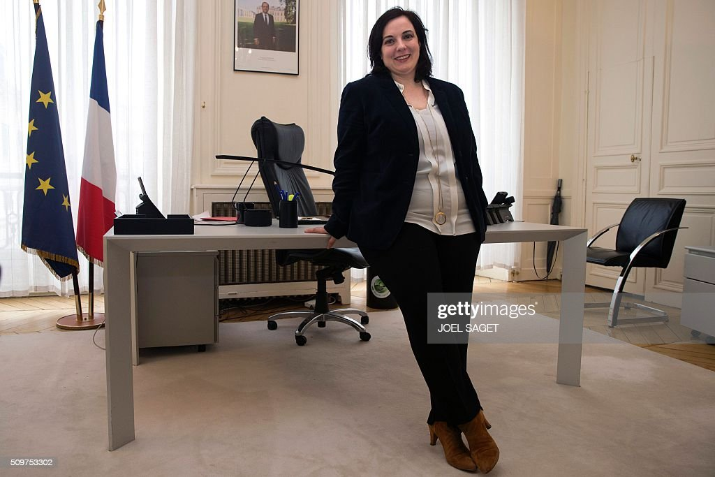 Emmanuelle Cosse, named as French housing minister, poses on February 12, 2016, after the handover ceremony in Paris. French President Francois Hollande reshuffled his cabinet on February 11, 2016, naming Jean-Marc Ayrault foreign minister and adding several ecologists to government as he seeks to widen his political base ahead of a presidential poll in 2017. SAGET