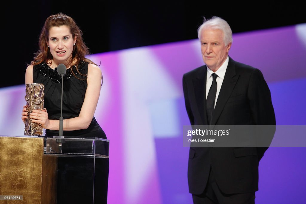Emmanuelle Devos and Andre Dussolier speak onstage during the 35th Cesar Film Awards held at Theatre du Chatelet on February 27 2010 in Paris France
